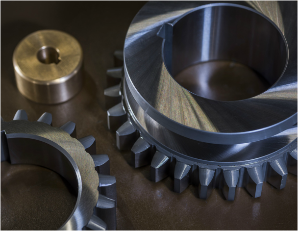 Two gears that have been chrome plated for Kenward Engineering